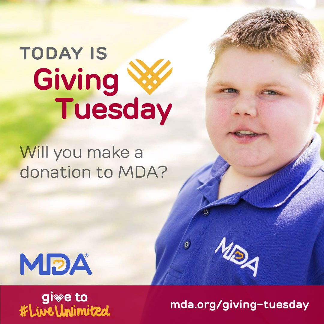 A boy wearing an MDA shirt