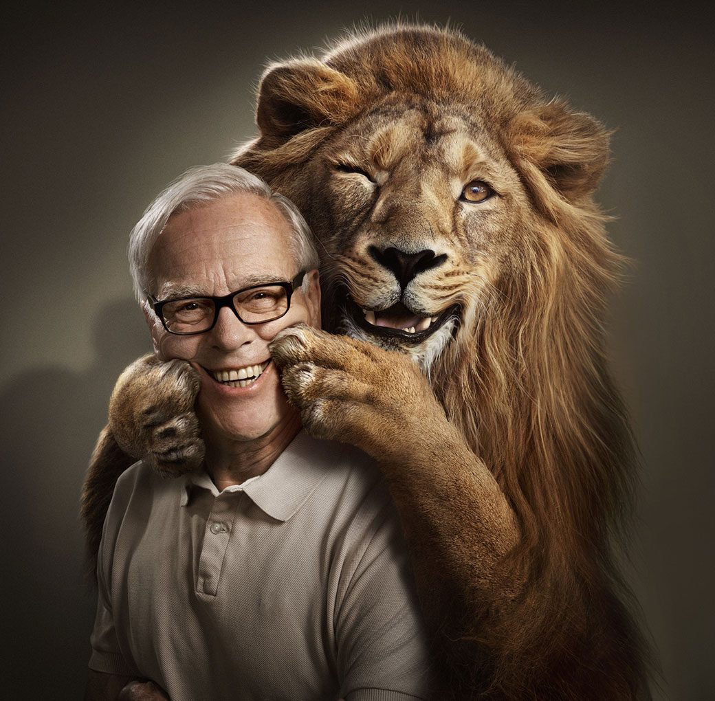 Man smiling with lion