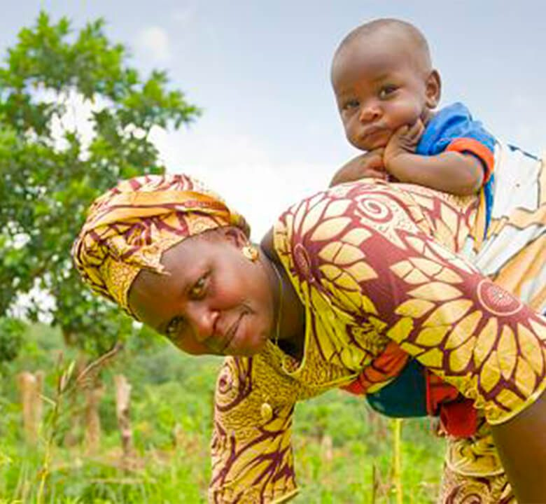 a woman in africa playing with her child