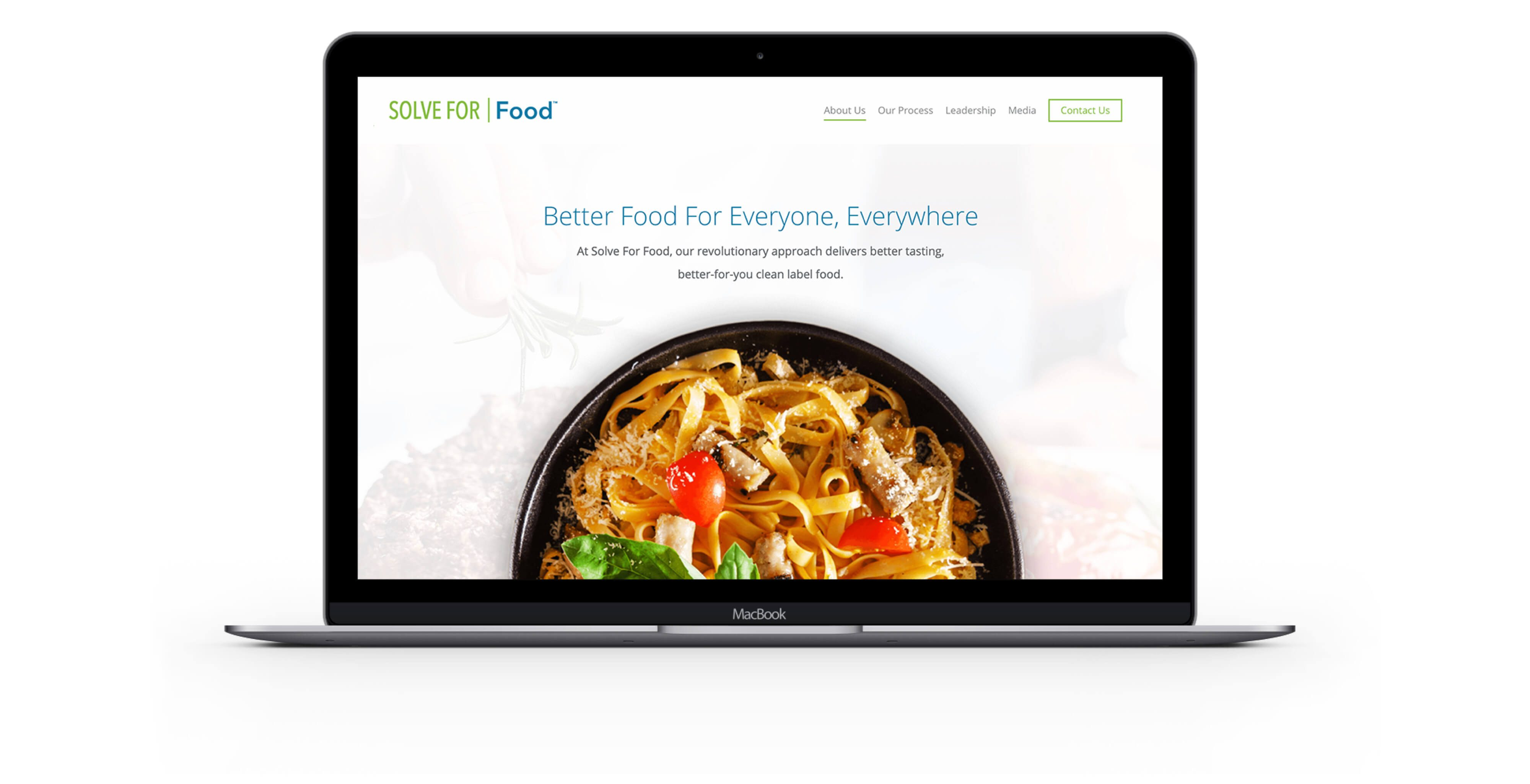 a mock up of the solve for food website on a macbook pro