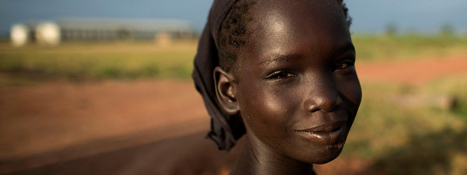 a young girl in smiling for the camera