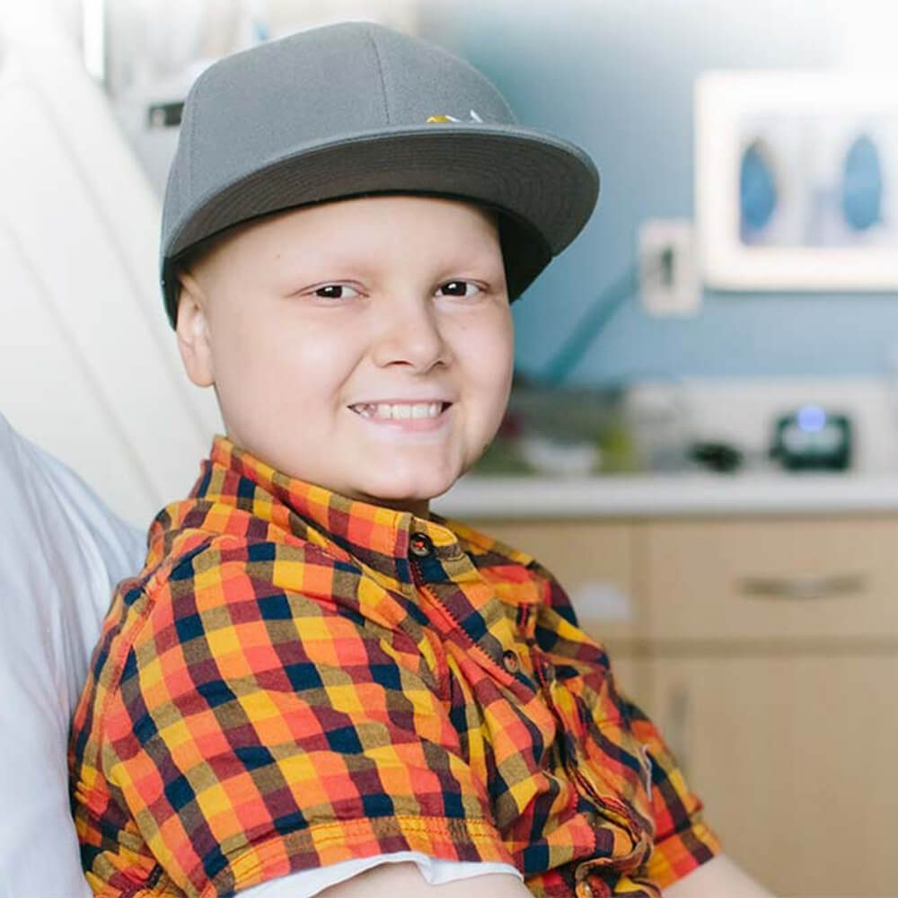 a young boy posing in a hospital bed