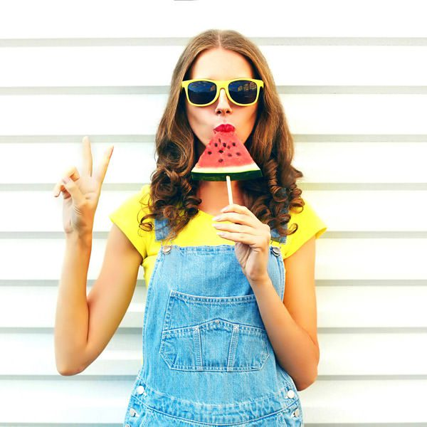 Girl in sunglasses with watermelon during summertime